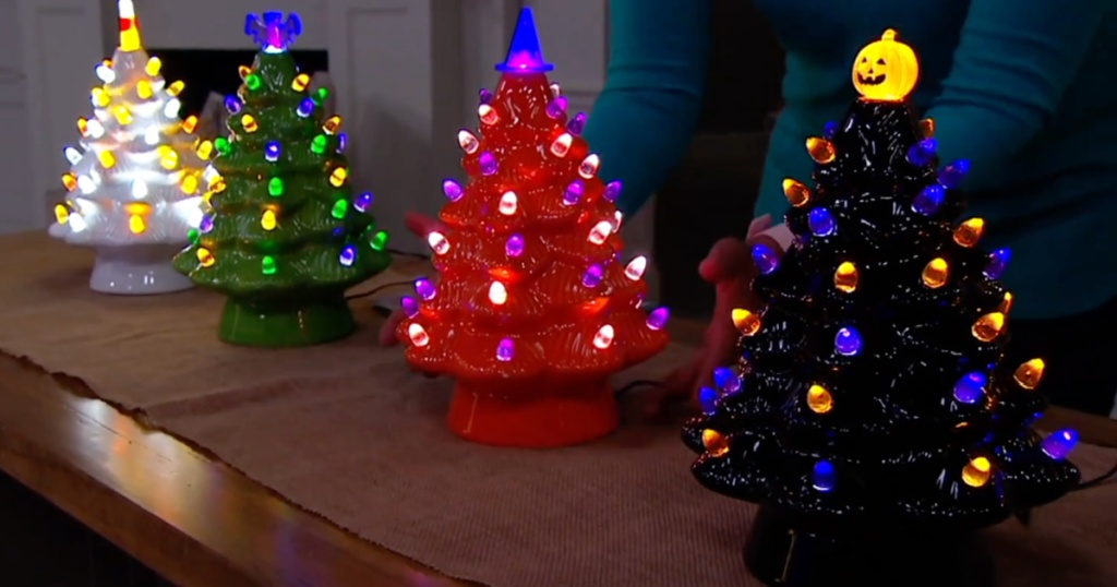 Halloween ceramic trees lit up in the dark on countergtop
