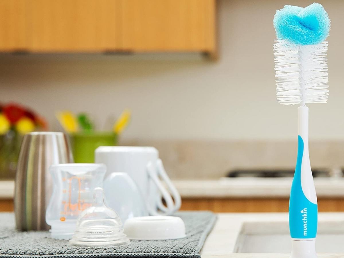 munchkin bottle brush sponge standing on counter