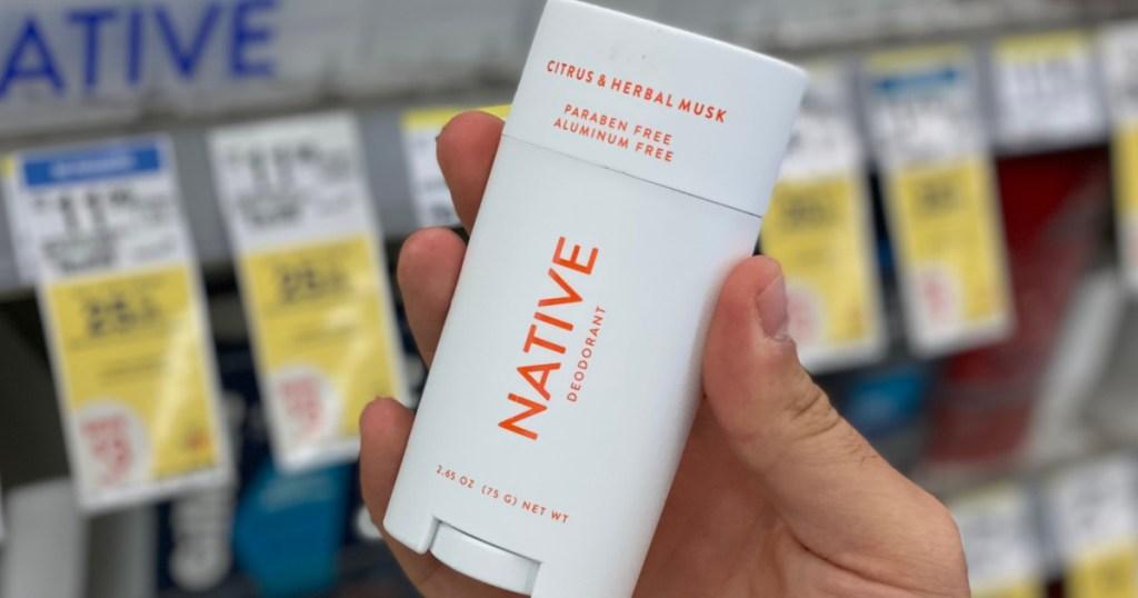 hand holding white deodorant