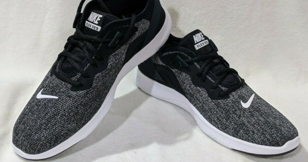 pair of women's black sneakers