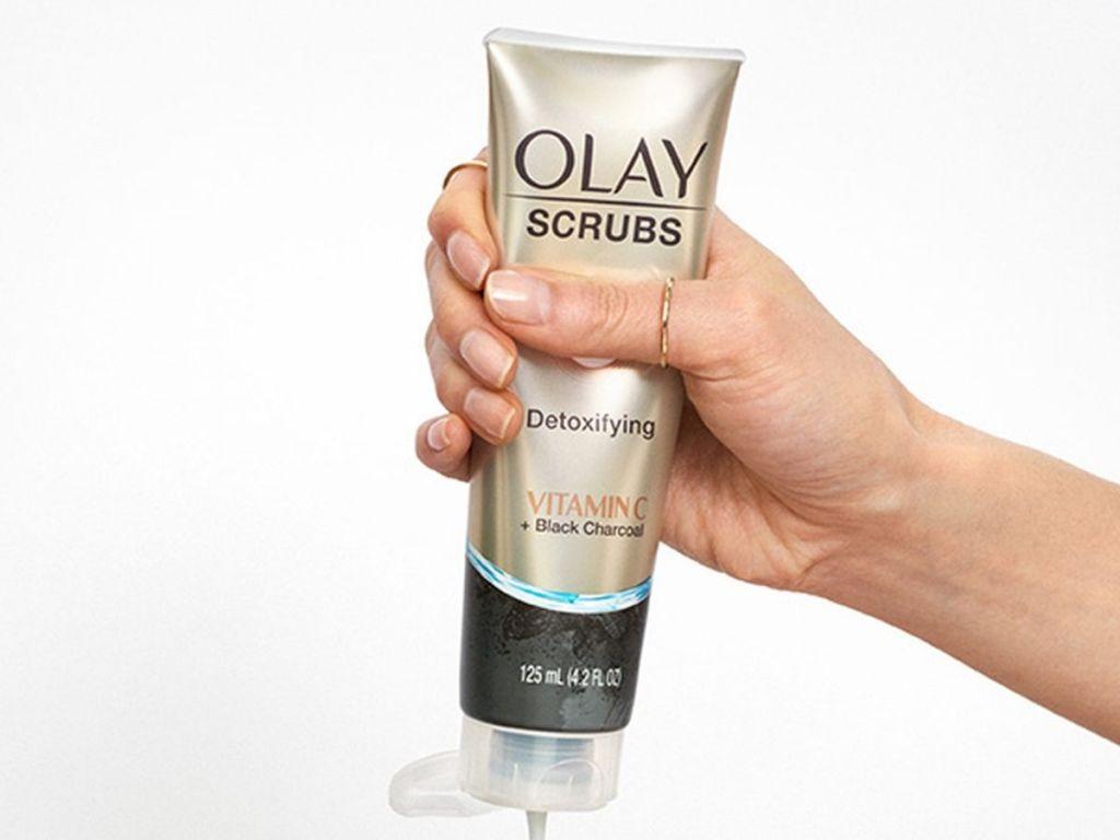 hand holding an Olay scrub