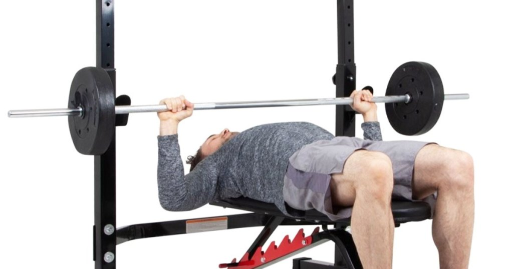 man lifting weights on weight bench