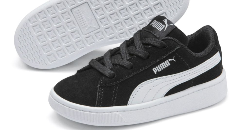 pair of black and white puma sneakers