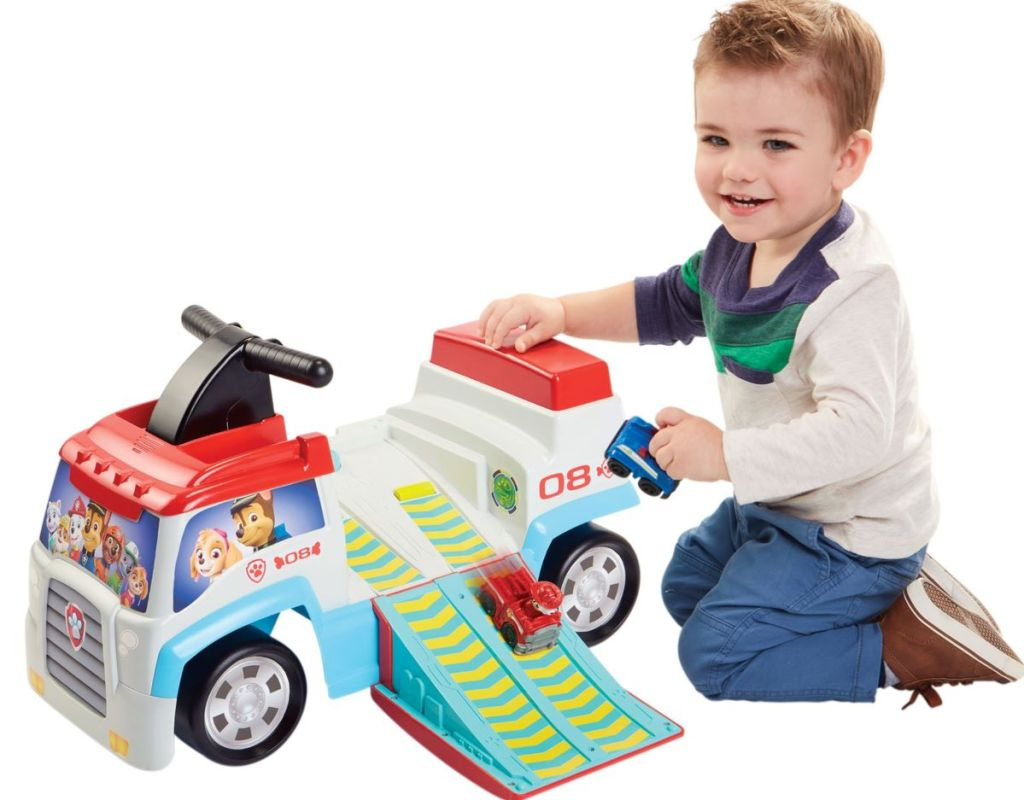 boy playing with a Paw Patrol ride-on