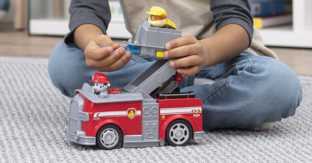 boy playing with a Paw Patrol Transforming Fire Truck