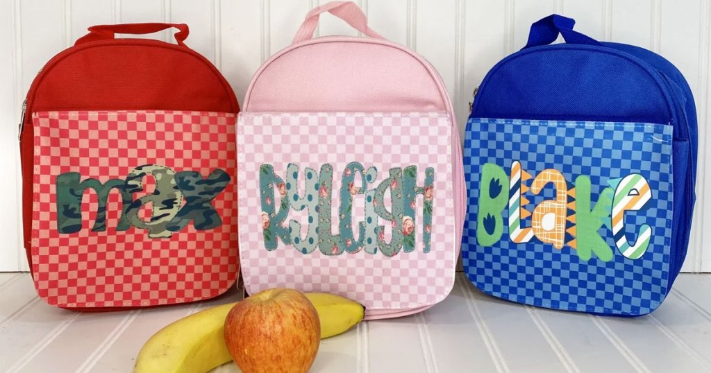 three personalized kids lunch totes