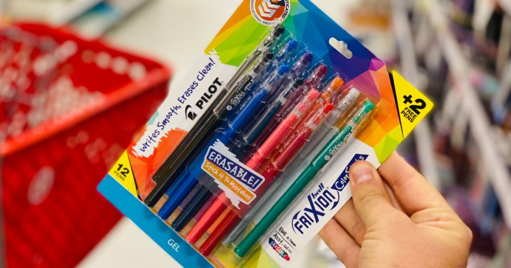 hand holding pack of colorful pens