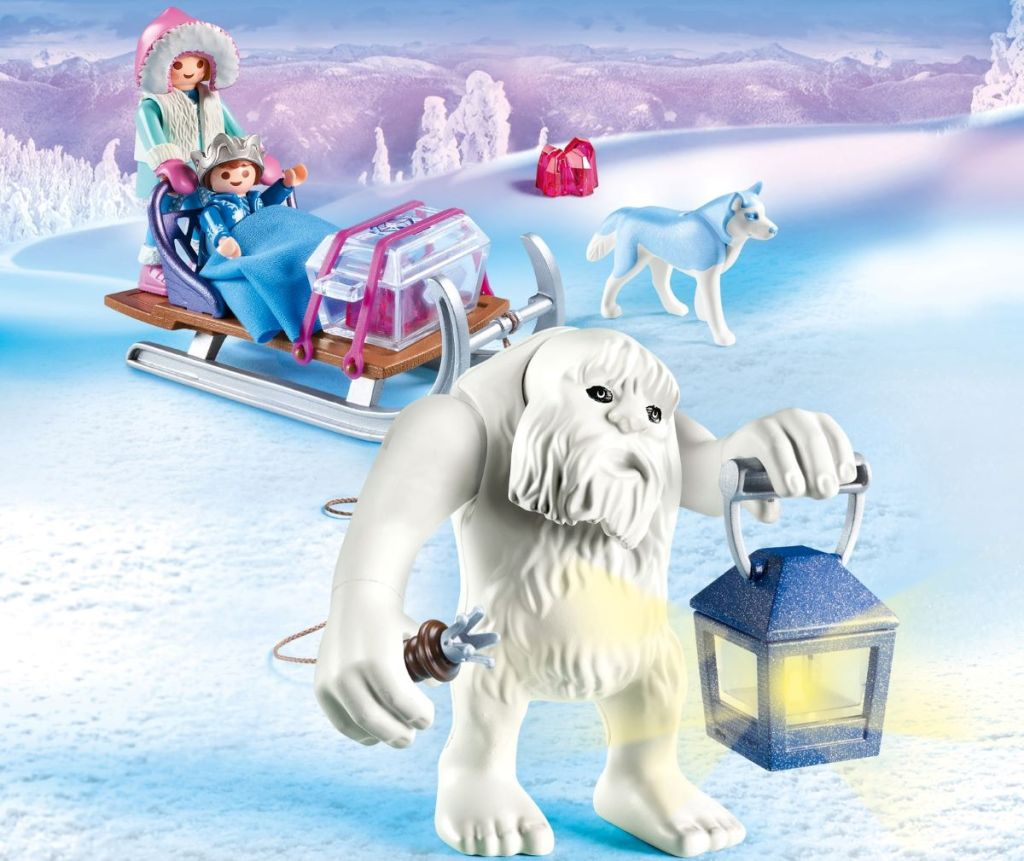 yeti figure and figures on a sled