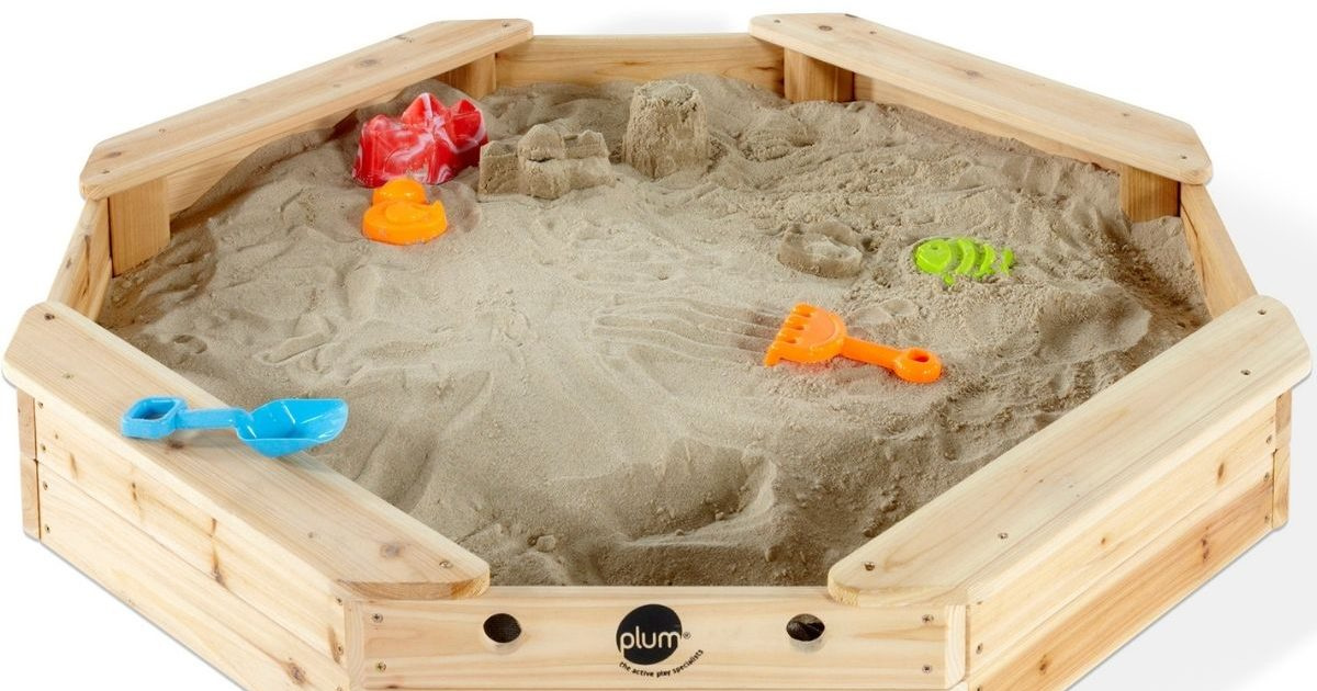 kids wooden sandbox filled with sand and toys