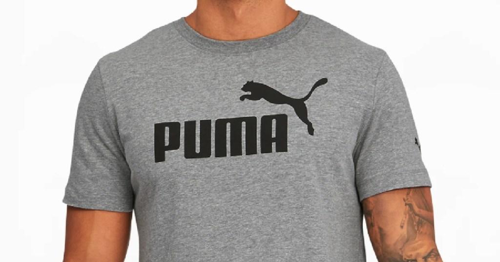 man wearing puma tee