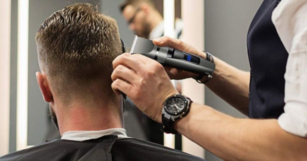 man cutting another mans hair