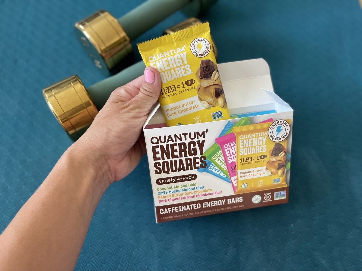 hand holding a bar from a Quantum Energy Squares Variety Pack