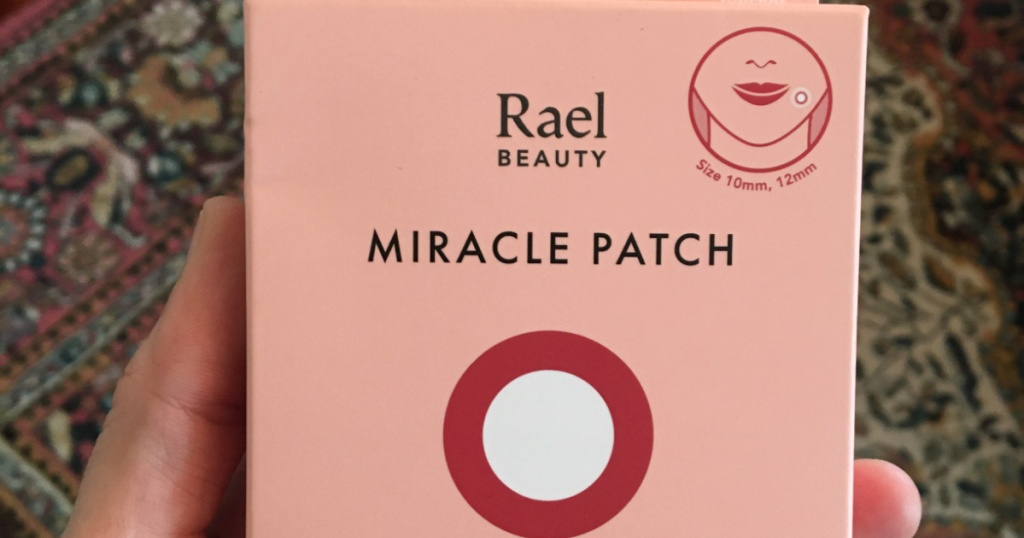 Woman holding a box of Rael Beauty Miracle Patch
