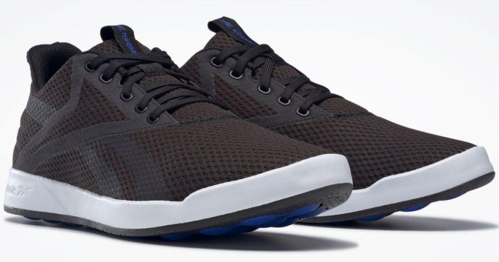 pair of white and black Reebok sneakers