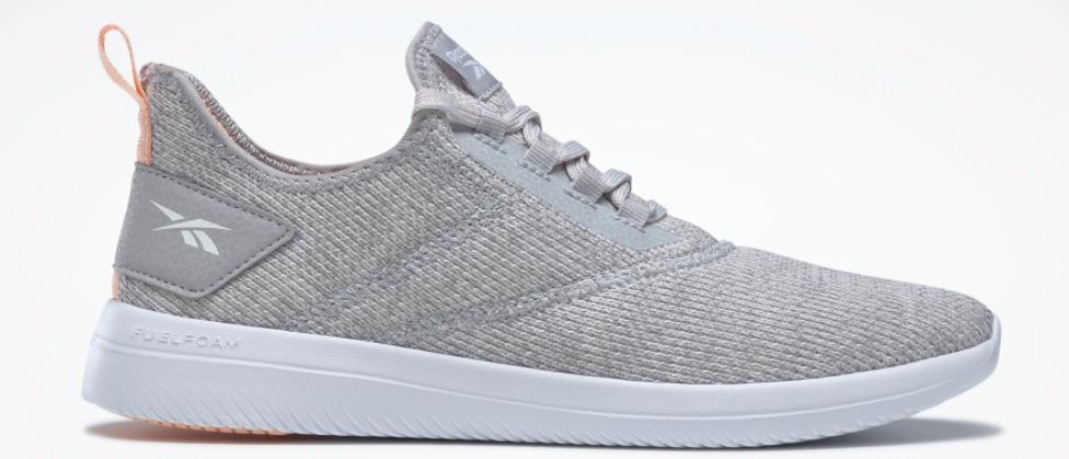 grey and white Reebok sneaker
