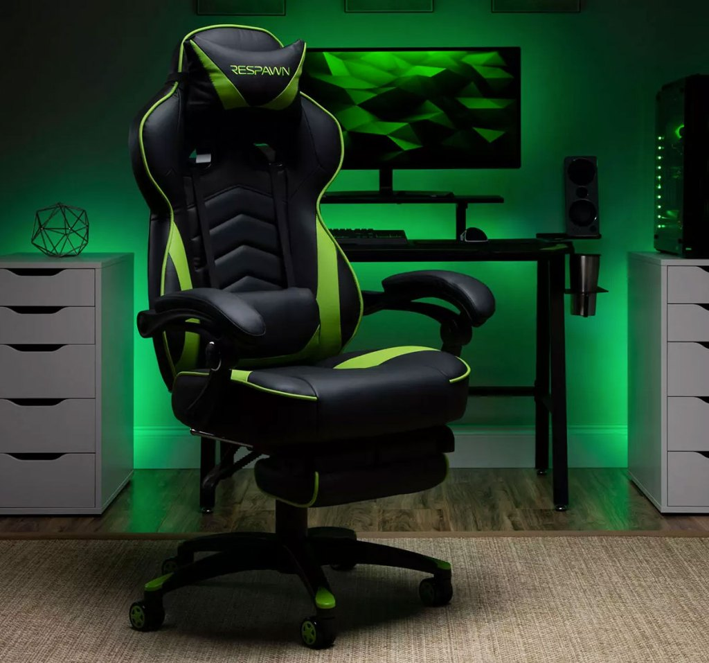 green and black gaming chair in front of desk