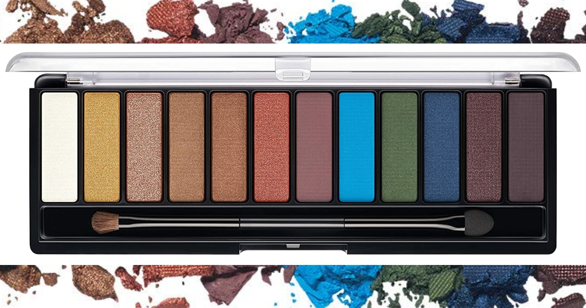Rimmel Eyeshadow Palette of many different colors open with a makeup brush inside and eyeshadow colors loose around the background