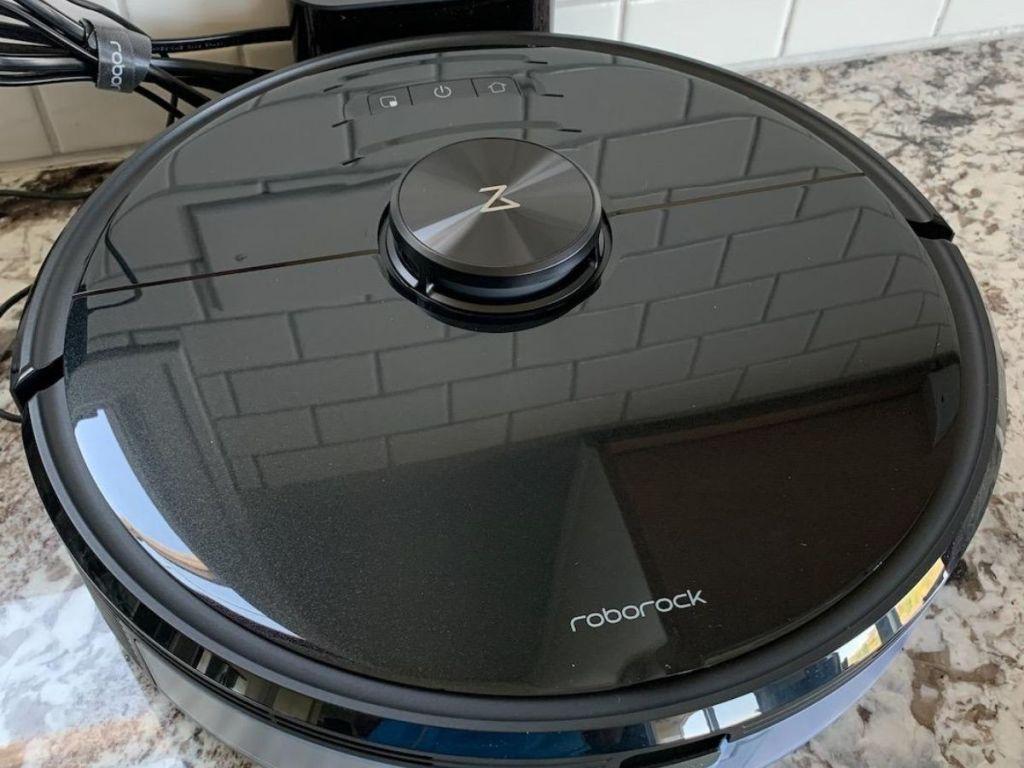 black roborock robot vacuum on charger