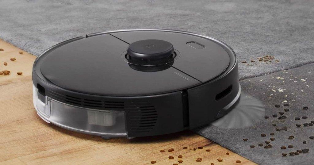 robotic vacuum on wood and carpet floor