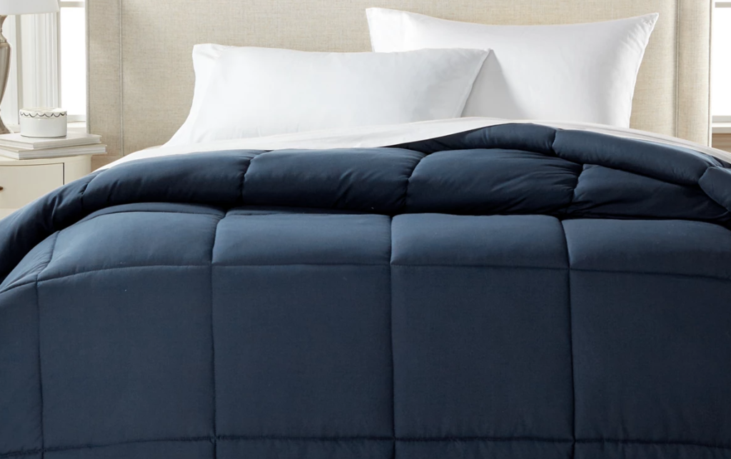 blue comforter on a bed