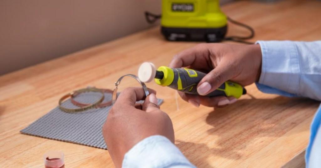hand holding a ryobi precision tool