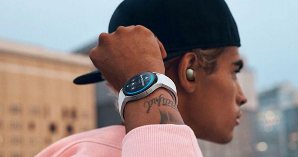man wearing gray smartwatch