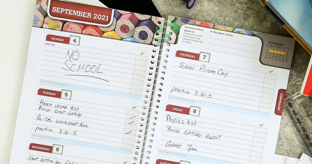 two open pages of a school planner