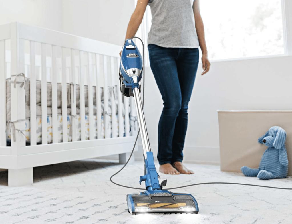 woman vacuuming a rug