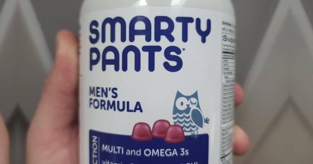 hand holding smartypants men's vitamins