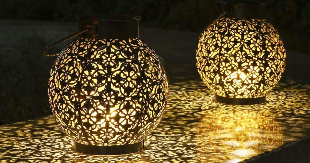 two solar lanterns on table