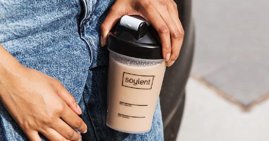 hand holding soylent protein shake