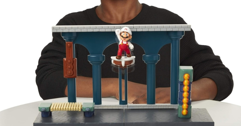 super mario lava castle play set with boy playing