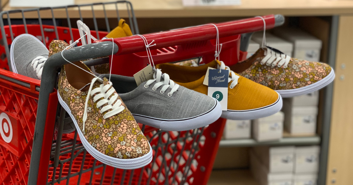 women's sneakers hanging from shopping cart