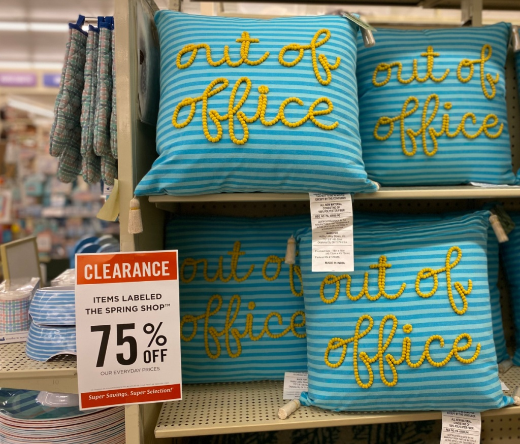 """""""out of office"""" tassled throw pillows on display in-store"""