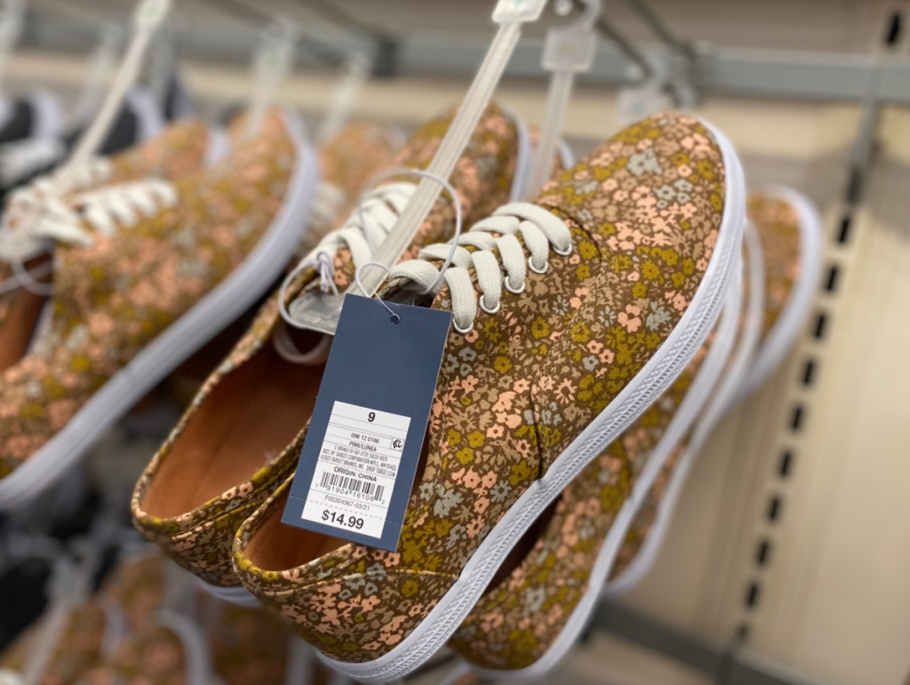 floral shoes on hanger in-store