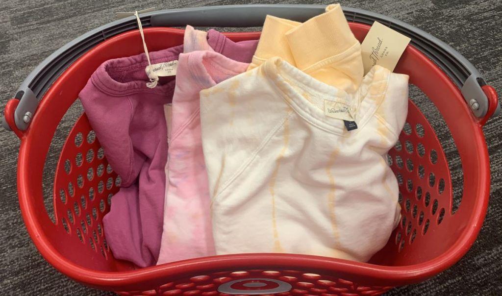 sweatshirts in a basket