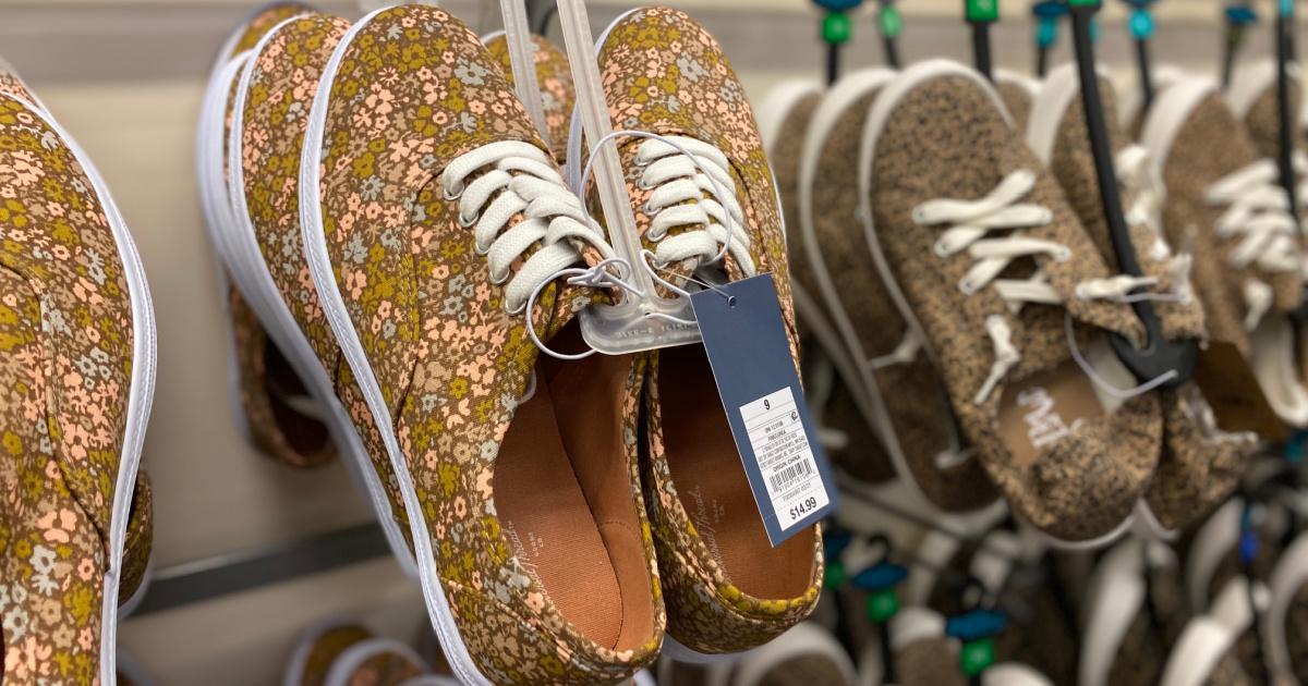 women's floral sneakers on display