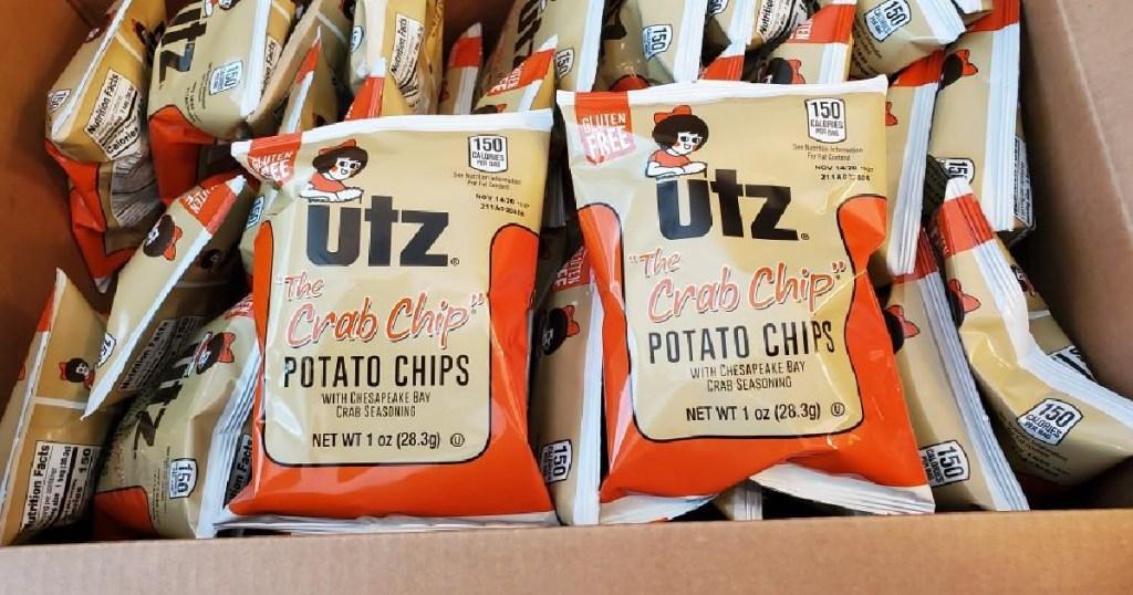box full of small bags of Utz brand chips