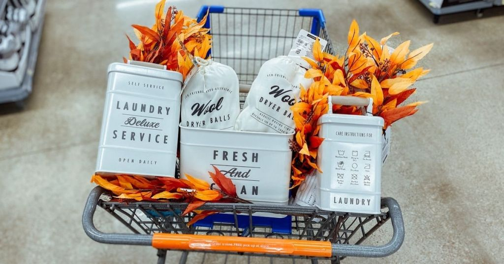 Walmart shopping cart filled with farmhouse style laundry decor