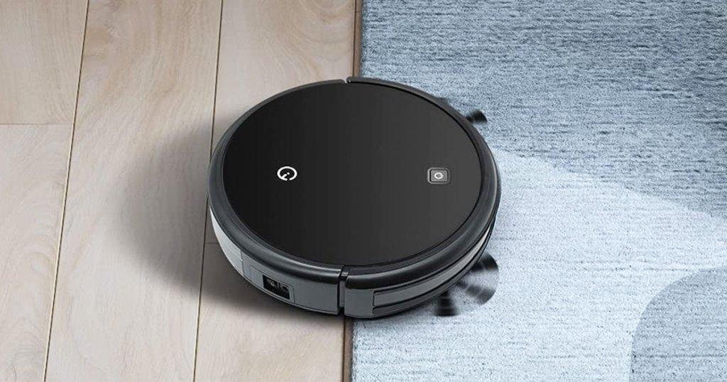 black robotic vacuum cleaning floors