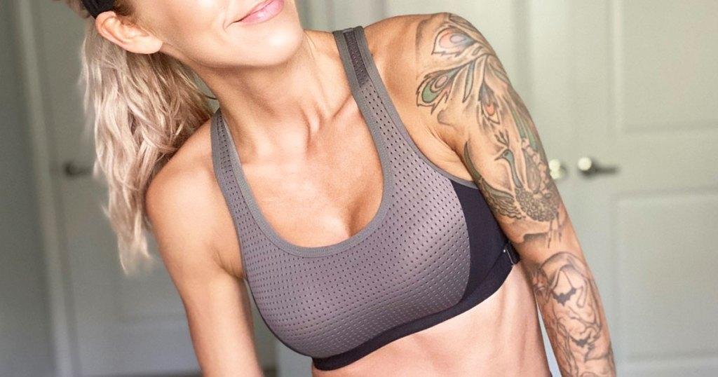 woman wearing a grey and black sports bra