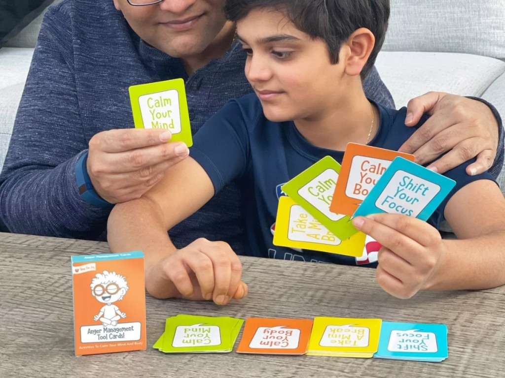 father & son using anger management cards