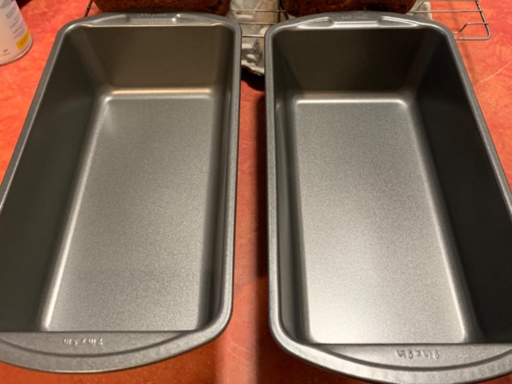 2 baking pans sitting on kitchen counter