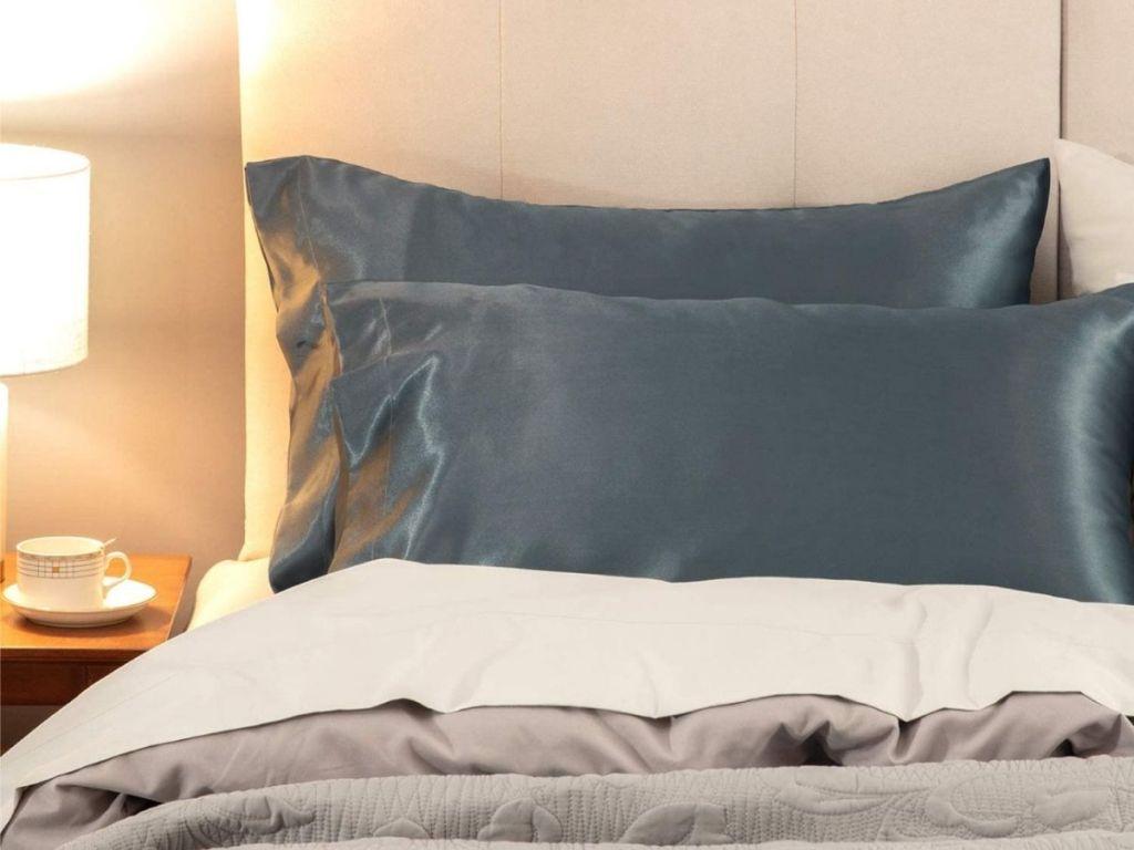 blue satin pillowcase on bed