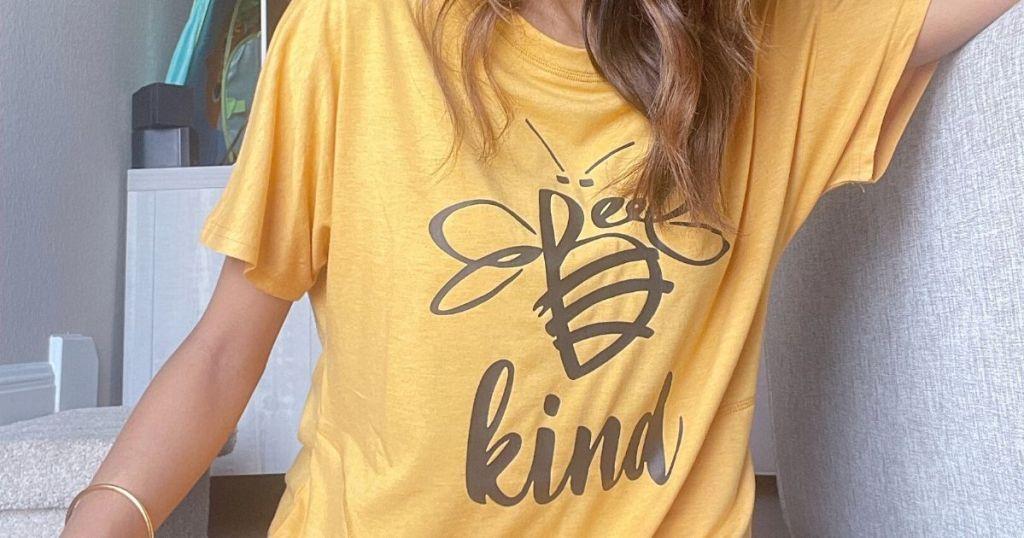 woman wearing Bee Kind yellow tee