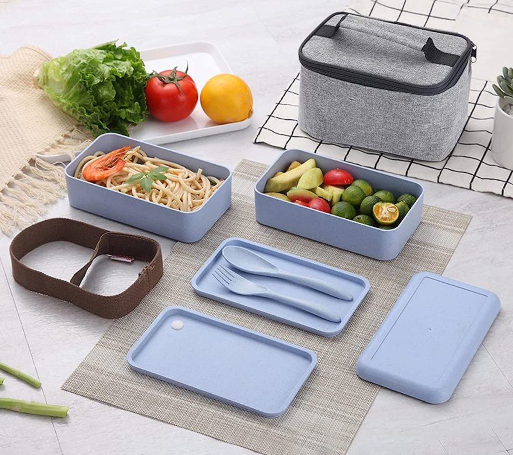 bento box with bag and food spread out on kitchen countertop