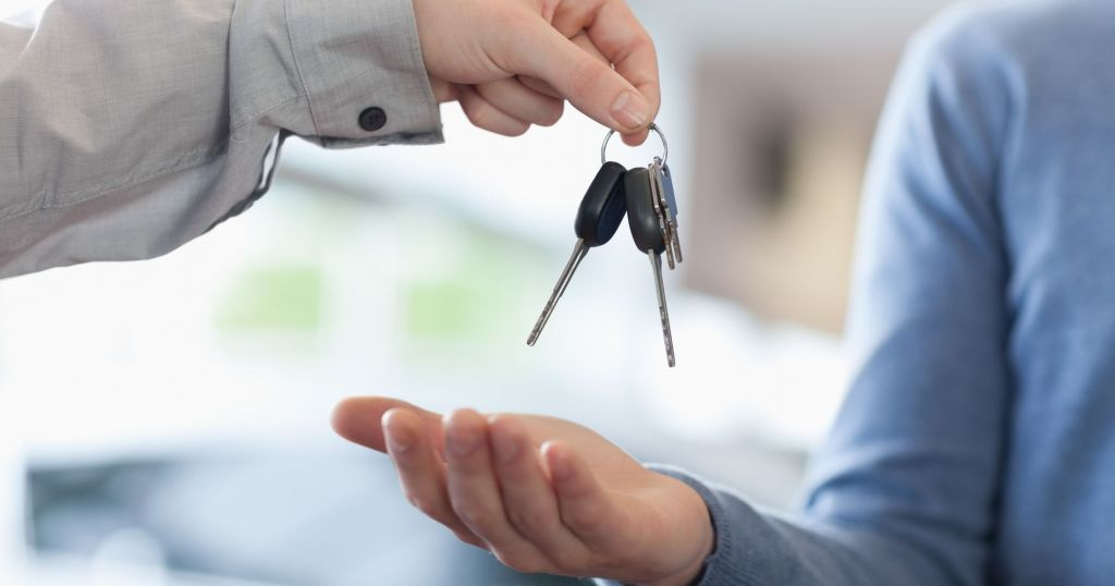 people exchanging car keys