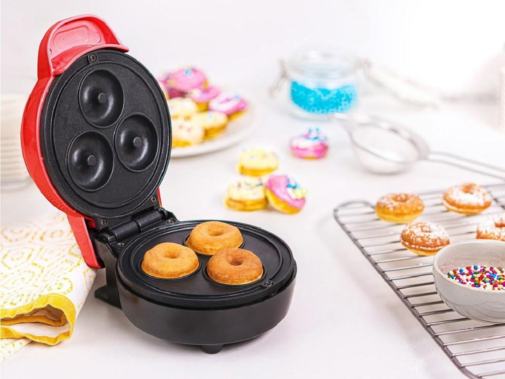 little machine that makes mini donuts on kitchen counter