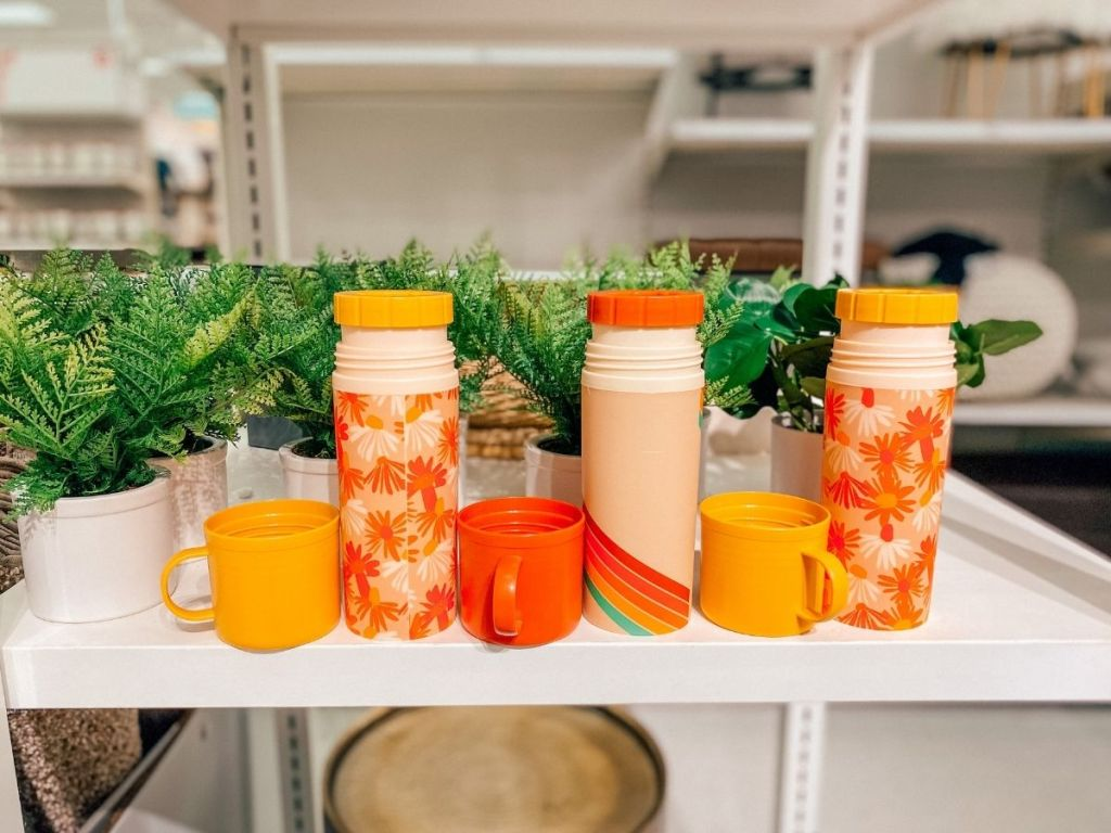 floral and rainbow beverage containers and lids