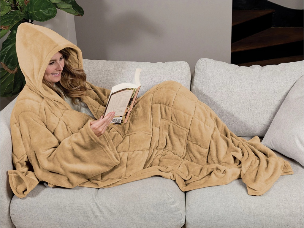 woman on couch in a wearable blanket